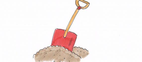 czerwona łopatka w piasku, rysunek odręczny